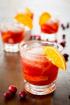 Cranberry Tangerine Negroni, made with whole cranberries and fresh tangerines! A bitter and sweet cocktail for the holiday season! Via @healthyseasonal