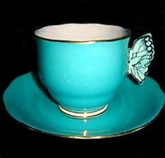Royal Albert...Striking Turquoise Teacup and Saucer with Butterfly Handle
