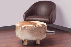 Large Round Leather/Cowhide Ottoman. FREE SHIPPING. $250.00, via Etsy.
