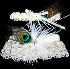 Two stunning ivory bridal garters. One with beaded lace and a special rhinestone crystal center. The other garter is a smaller version to toss.