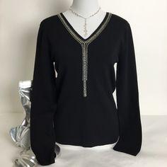 Belldini Embellished V-Neck Sweater Belldini Sweater with rhinestone embellishment along the v-neckline. Pre loved in good condition. 65% rayon, 35% nylon. Belldini Sweaters V-Necks