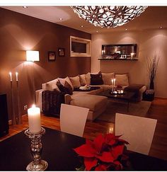 Really nice livingroom wall colour, very warm & cozy. Never would have thought of that colour myself