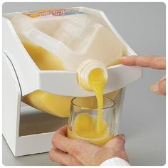 The Pour Thing allows the user to pour the container with just two fingers and you don't even have to take it out of the refrigerator.
