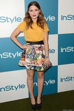 Sophia Bush went for a cute floral skater skirt which she accessorised with cocktail rings.