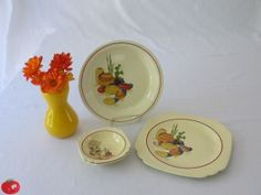 "In the late 30s, The Homer Laughlin China Company introduced some Mexican-style lines of dinnerware.  They introduced Conchita, Hacienda, Max-i-cana, Mexicali, Mexicana and Ranchera.  Here are some of my dishes from the Hacienda and Mexicana lines.  The pie plate (standing up) is Mexicana, and is stamped ""Kitchen Kraft"" and is not dated.  The large plate (also Mexicana) is stamped ""Homer Laughlin 1939.""  The two fruit bowls are Hacienda and are stamped ""Homer Laughlin 1937."""