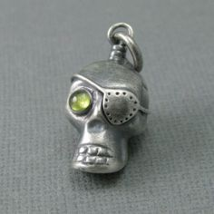 Sterling silver pirate skull with peridot eye