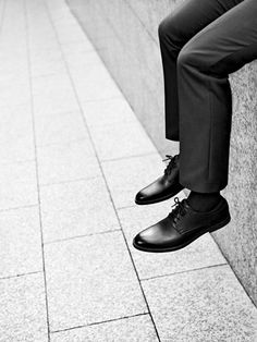 Timeless Modern Tactile Functional Men's shoes with slim cigarette pant trouser legs. By Cos clothing stores.