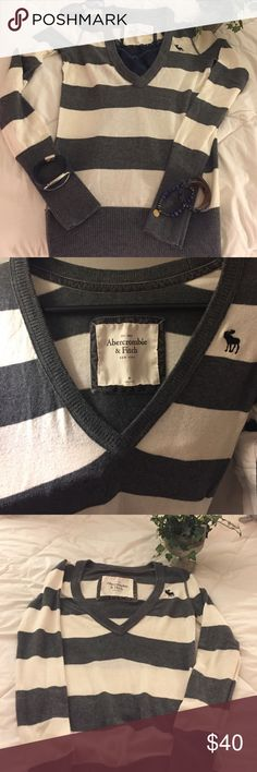 Abercrombie Sweater- V neck Gorgeous Gray, Cream, Blue V-neck sweater. Great condition. Like new. No snags or holes piling. Very soft and comfortable. Very versatile in color combinations that can be worn with it. Abercrombie & Fitch Sweaters V-Necks