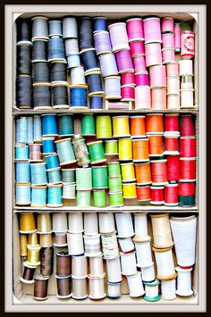 rainbow of thread << #sewing #storage #thread Now here's a thought: store thread horizontally rather than upright on pins. So that similar colours can be stored together even if they're on spools of different sizes and diameters.