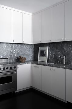 """A clear vision for a white marble backsplash was foiled when the pair couldn't find what they wanted at the slab yard. But it was for the best. Weisman was drawn to a French marble slab that Cassidy had actually been showing clients and was dying to use. """"I actually laughed because he was going for what I've wanted forever,"""" says Cassidy of the weathered cementlike piece that proved they had the same taste, even when they came to the same idea separately."""
