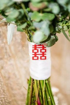 East Meets Dress Blog - Use pops of red and double happiness in your bouquet sash