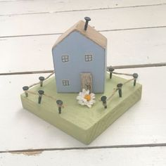 Blue Decorative House £15.95  Miniature wood house hand painted in Blue set on a wood garden.