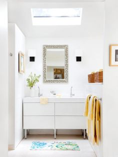 Let There Be Light  Like the master bedroom, the master bathroom features crisp white walls and neutral flooring. A modern-style white vanity boasts plenty of drawer space for bathroom necessities. Overhead, a skylight adds to the open feeling the homeowners strived to create throughout the home by allowing sunlight to stream in from the outdoors.