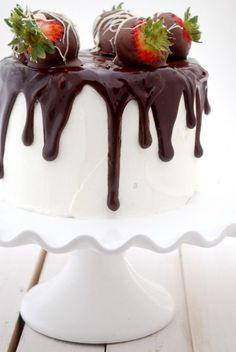 Dripping Chocolate And Strawberries Pedestal White Cake
