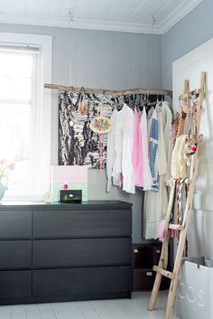 Exposed closet made from driftwood branch