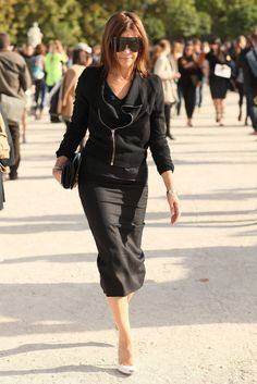 Carine Roitfeld in a fitted pencil skirt and visor-style sunglasses.