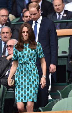 Kate Middleton wore a stunning wrap dress while attending Wimbledon with Prince William on Sunday, July Plus, Victoria and David Beckham attend Kate Middleton Wimbledon, Looks Kate Middleton, Kate Middleton Outfits, 2014 Wimbledon, Prince William Family, Prince William And Kate, William Kate, Victoria And David, Princesa Kate Middleton