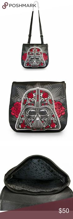 Darth Vader and roses Loungefly purse Description+  Style from the Dark Side... This wicked cross-body messenger bag combines two of our most favorite themes; Star Wars & Day of the Dead! It is made of supple black faux-leather (vinyl) and features awesome artwork that depicts Darth Vader's helmet embellished like a sugar skull in the Dia de Los Muertos (Day of the Dead) style, complete with embroidered red roses, and metallic silver flourishes. Loungefly Bags