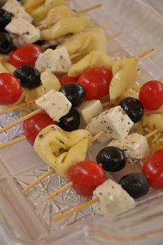tortellini , feta, and tomato skewers, looks like they are marinated in italian dressing