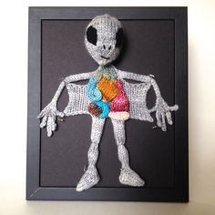 Knitted Alien Autopsy: Framed with Black Background by aKNITomy on Etsy https://www.etsy.com/listing/198981250/knitted-alien-autopsy-framed-with-black