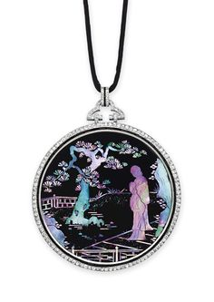 AN ART DECO DIAMOND, ENAMEL, ONYX AND MOTHER-OF-PEARL PENDANT NECKLACE, BY CARTIER - circa 1925.