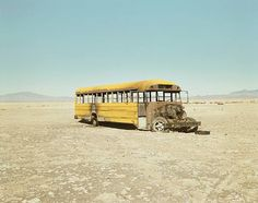 Richard Misrach He photographs the mark/impact left behind by human interaction with nature. His pieces are often very simple, but speak a thousand words. This old broken down school bus left behind in a sparse open space makes you wonder what it was doing their in the first place.
