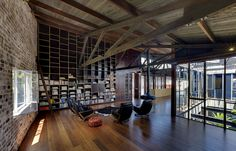 Working and meeting space where natural, modern and old building materials are used in the same space.