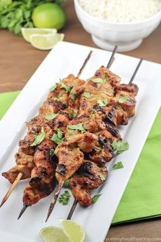Marinated and grilled Thai Coconut Chicken Skewers over a bed of delicious coconut rice!