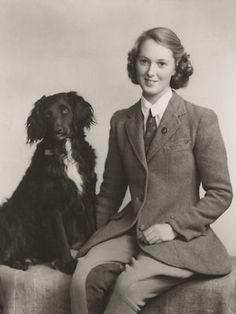 Young Jane Goodall with her dog, Rusty. Before she went to Tanzania to study wild chimpanzees at age 26, she worked as a London film studio assistant and as a waitress.
