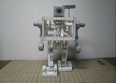 Walking Paper Robot: A new kit from a Japanese paper-modeling expert uses rubber bands to make a robot take steps. The design relies on some truly inspired engineering,