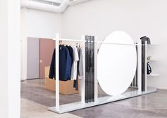 Brook&Lyn has used pastel-coloured panels and a huge circular mirror to create the first physical showroom for Everlane
