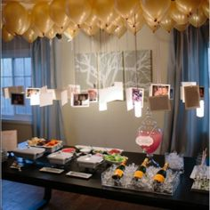 pictures hanging from balloons.