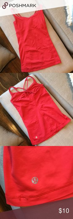 Red LULULEMON tank Red tank top by Lululemon. Has one small snag but is in good shape. lululemon athletica Tops Tank Tops