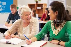 Teacher and student sit together at an adult education class royalty-free stock photo