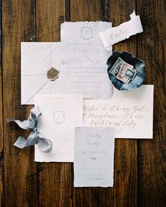 pretty gold, white and blue wedding invitation with a gold wax seal