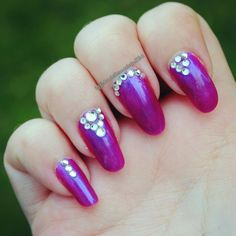 a very easy nail art design of painting the nails a solid color and adding a crap ton of rhinestones in all different patterns to the nails created by, @daniellem824