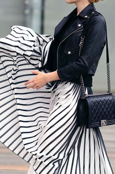 Striped pleated skirt and moto jacket.