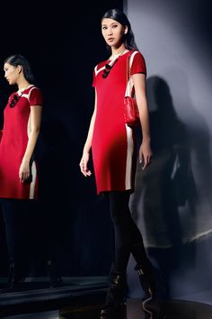 Contrasting ideas: This slim-fitting wool qipao dress nods to this season's styling with a neat contrasting trim.