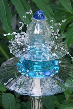 garden sculpture from recycled kitchen glassware