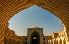 Looking through the brick entrance of a Mosque in iran