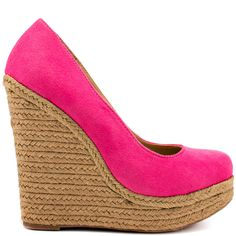 You won't get enough of Izzy!  This Just Fab pump brings you a bright pink micro suede upper and rounded toe.  A 5 1/2 inch wedge and 1 1/2 inch platform is covered in espadrille to create a casual look.