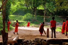 Cricket has an integral 'stop-frame' nature..when everything stops. This photo captures that beautifully..with light, colours and more than anything else..the context. Lovely  Sri Lanka: Young monks playing a game of cricket.