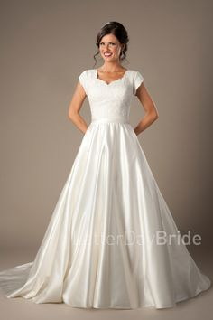 Aldridge | Modest Wedding Dresses | LatterDayBride & Prom | Salt Lake City | Utah | Worldwide Shipping | LDS Bridal Gown | This lovely A-line satin skirt features a sweetheart neckline with a unique lace bodice and flattering cinched waistband.    Gown available in Ivory only    *Gown pictured in Ivory