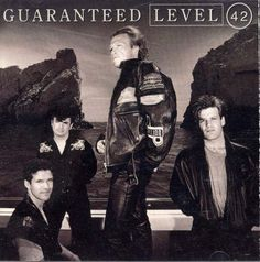 Level 42 Guaranteed Album Cover  My 1st Level 42 album.  The bass line in Seven Years is sublime!