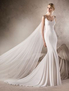 Hasina WEDDING DRESSES 2017 Marvellous mermaid wedding dress in crepe with round neckline. A sparkling design with tulle and gemstone embroidery details on the shoulders and around the back.