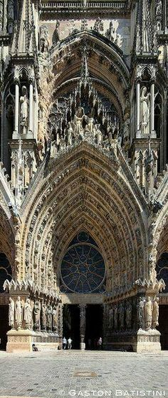French Gothic facade door of Notre-Dame de Reims Cathedral (Our Lady of Reims) where the Kings of France were crowned in Reims, France.
