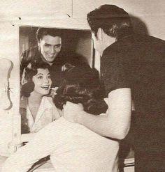Judy Tyler and Elvis Presley behind the scenes of JAILHOUSE ROCK, 1957
