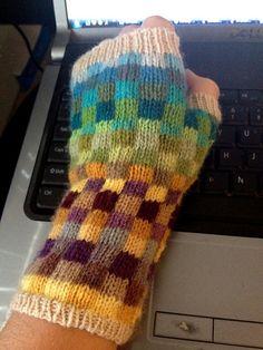 Ravelry: Mosaic Happy Fingerless Gloves by Taiga Hilliard Designs.