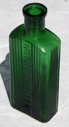 Antique Green Glass Poison Bottle.