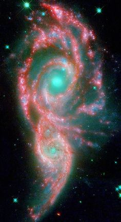 These shape-shifting galaxies have taken on the form of a giant mask. The icy blue eyes are actually the cores of two merging galaxies, called NGC 2207 and IC 2163, and the mask is their spiral arms.